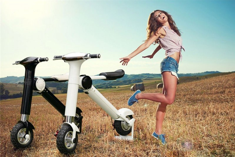 Cheap affordable sit on electric battery powered Micro scooter vehicle